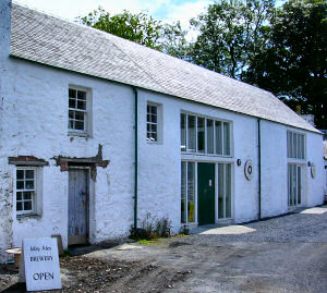 Picture of a whitewashed building housing a distillery