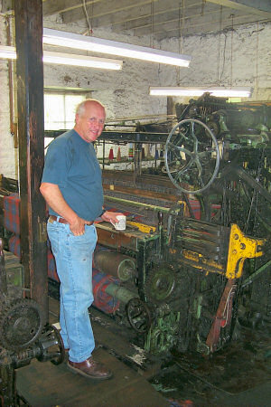 Picture of a man standing in a woollen mill