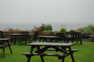 Picture of a view over wet benches into a grey and rainy distance