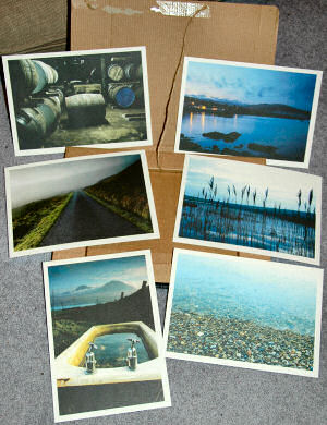 Picture of 6 postcards spread out on an envelope/box