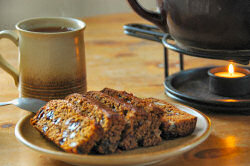 Picture of slices of Islay Loaf on a plate with some tea in the background