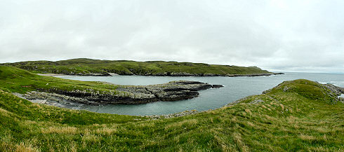 Picture of a panoramic view over a long bay (Kilchiaran Bay on Islay)