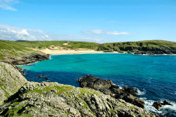 Picture of a beautiful sandy bay in brilliant sunshine (Lossit Bay, Islay)