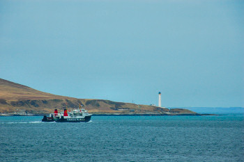 Picture of a ferry passing a lighthouse