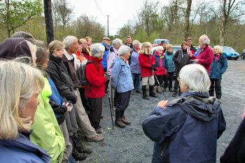 Picture of a group of walkers listening to a walk leader speaking