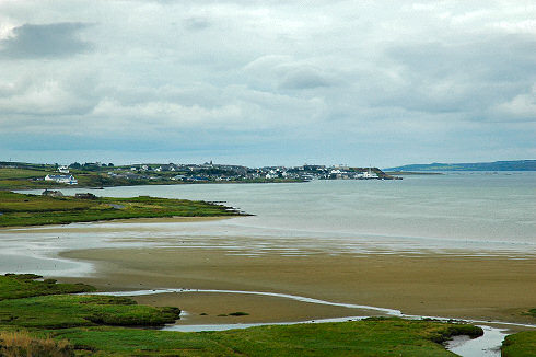 Picture of a view over a village (Bowmore, Isle of Islay) at the top of a sea loch (bay)