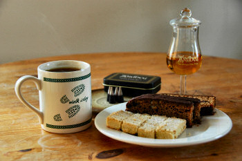 Picture of shortbread, Islay loaf, tea, Islay Single Malt, a cup of tea and smouldering peat cones