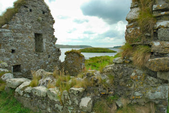 Picture of a view over ruins looking out to a small island (Finlaggan)
