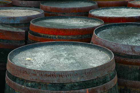 Picture of some old casks with rusty metal bands
