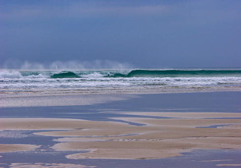 Picture of a wave breaking when approaching a beach (Machir Bay, Islay)