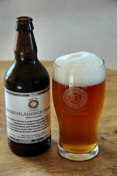 Picture of a bottle and pint of Bruichladdich Peat Ale by Islay Ales