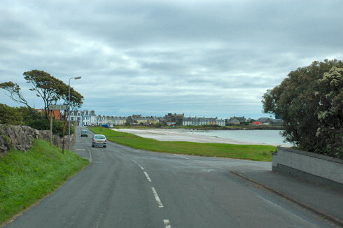 Picture of a road leading into a coastal village