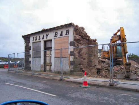 Picture of the last walls of a building to be demolished still remaining, the sign 'Islay Bar' still visible