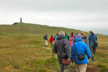 Picture of a group of walkers with a monument in the distance