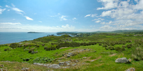 Picture of a wide panoramic view over a shoreline with a bay and a distillery