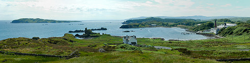 Picture of a panoramic view over a bay with a distillery, an island on the sea next to the bay