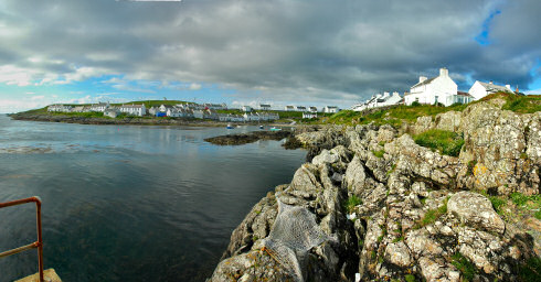 Picture of a panoramic view over a small coastal village around a small bay