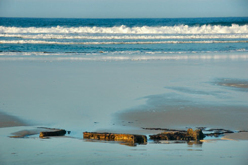 Picture of a wreck almost disappeared in the sand