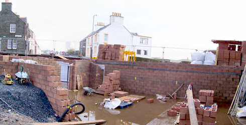 Picture of a panoramic view over a building site partly 'flooded' after a lot of rain
