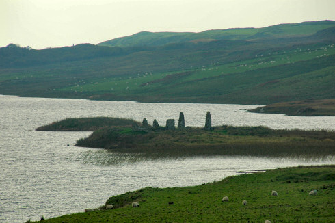 Picture of ruins of buildings on an island in a loch (lake)