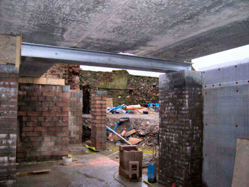 Picture of a view towards an opening in a basement under construction