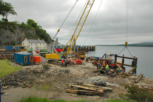 Picture of construction work on a small harbour on a sound between two islands