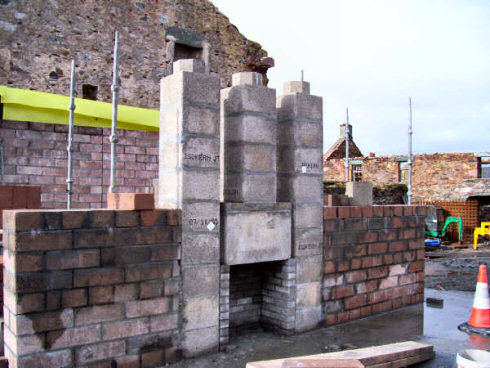 Picture of a fireplace under construction