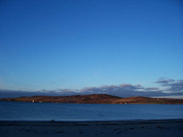 Picture of a wide bay in the early morning sunshine under a bright blue sky