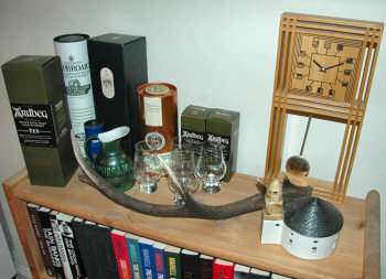 Picture of a shelf with various Islay related things