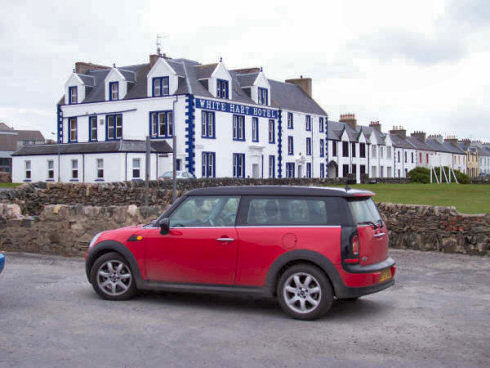 Picture of a red Mini Clubman in front of the White Hart Hotel in Port Ellen, Islay