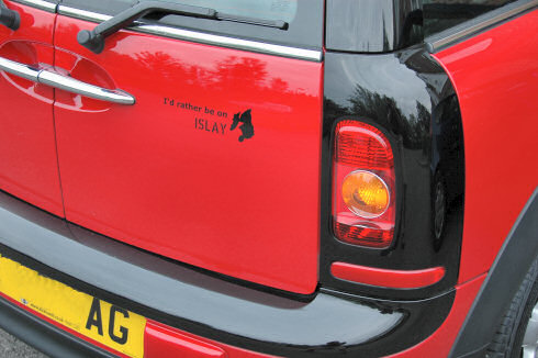 Picture of the back of a car with a sticker I'd rather be on Islay