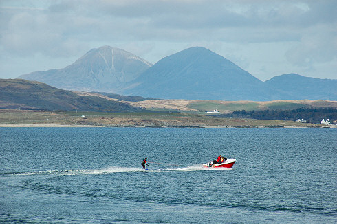 Picture of waterskiing on a sea loch on Islay. The Paps of Jura in the background.