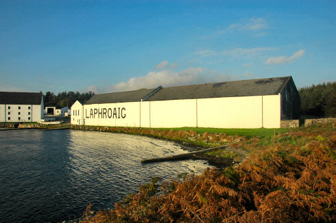 Picture of a huge whitewashed warehouse with the large lettering 'Laphroaig' on the side