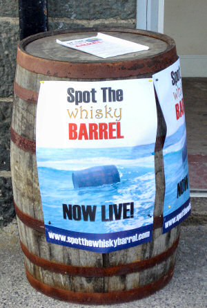 Picture of a barrel with posters promoting the 'Spot the Barrel' competition