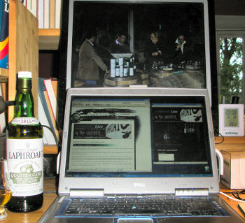 Picture of a laptop and an external monitor set up to watch the Laphroaig Live webcast, the whole panel on screen