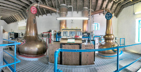 Picture of a panorama of the still house of a farm distillery (Kilchoman distillery on Islay)