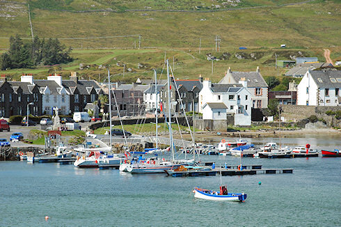 Picture of a view over a small sea loch harbour with a marina and a village