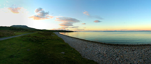 Picture of a beautiful bay with a pebble beach in the late evening sun
