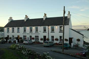 Picture of the Port Charlotte Hotel on Islay in the evening sun