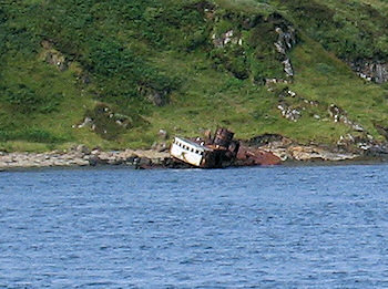 Picture of the wreck of a fishing trawler close to a rocky shore