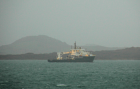 Picture of a navaids tender sheltering behind an island