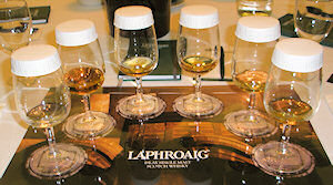 Picture of 6 glasses of whisky on a mat for whisky tasting