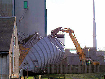 Picture of a digger working at a collapsed grain silo