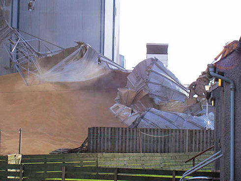Picture of grain spilling from a collapsed silo