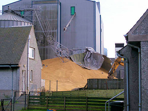 Picture of a collapsed grain silo at an industrial maltings