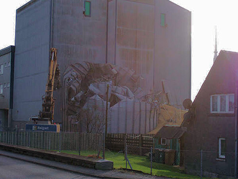 Picture of a grain silo being demolished