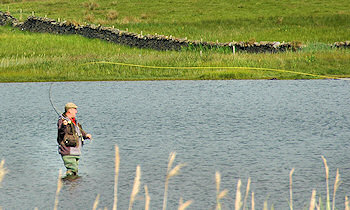 Picture of an angler flyfishing on a loch
