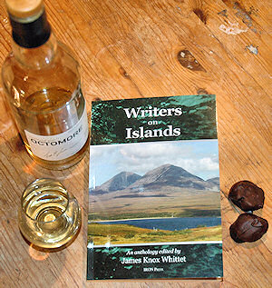 Picture of a book 'Writers on Islands' with Islay whisky and chocolate around it