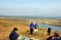 Picture of walkers on the summit of a hill, very hazy views