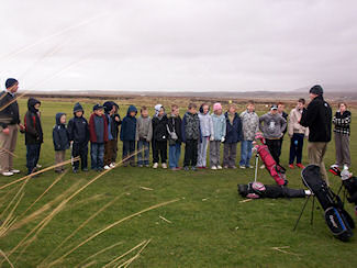 Picture of a group of children being taught by a golf teacher